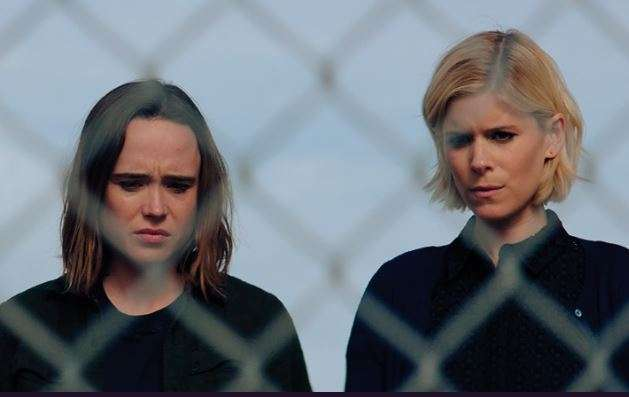 Ellen Page and Kate Mara looking at the ground