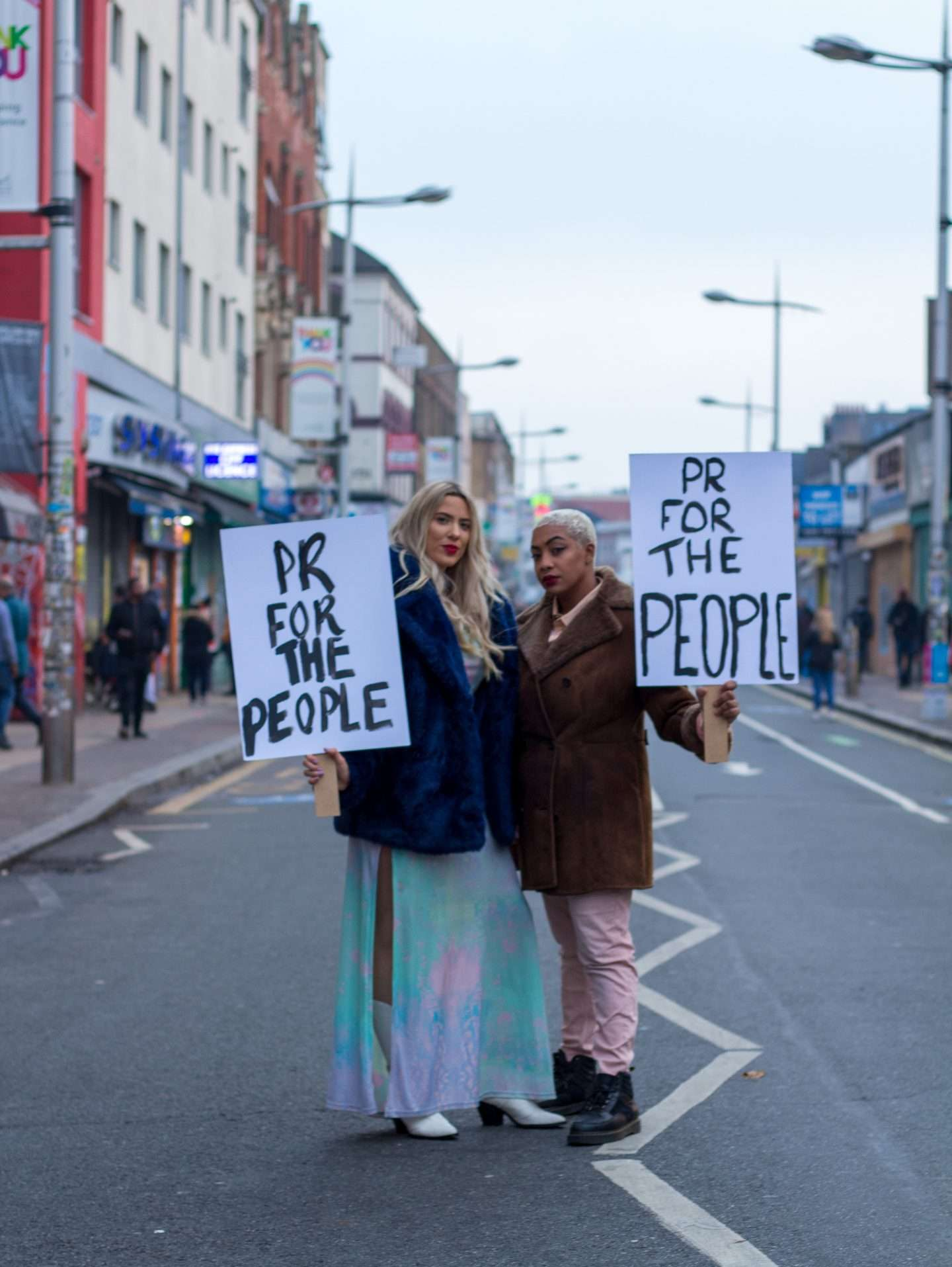 pr for the people with banners in street